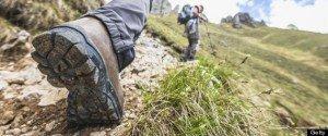 Hiker walks on Mountain Trail
